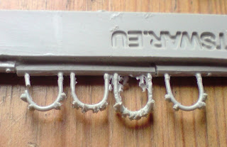Orky jaw-protectors on a sprue