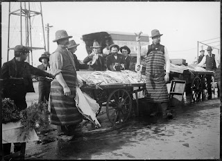 men in striped aprons at fish market in Coburg