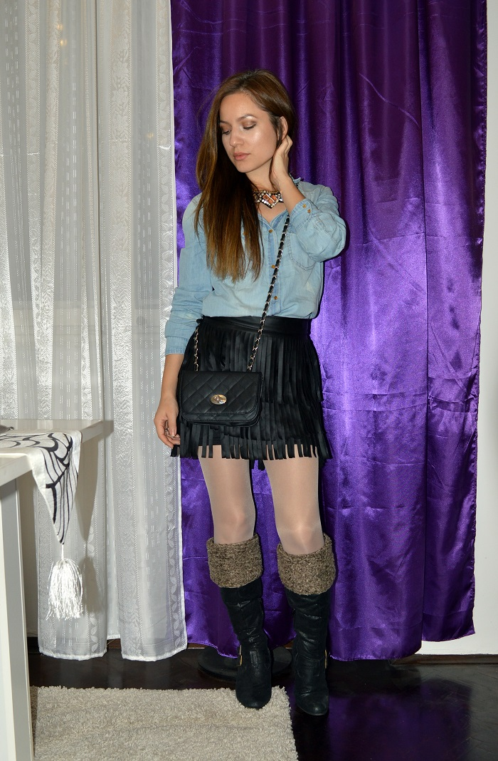 outfit, chambray shirt, black faux leather fringed skirt, blue denim shorts, over the knee boots, statement necklace, cross body bag