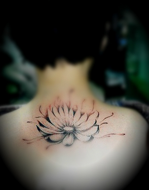 simple concise lotus flower tattoo on the back
