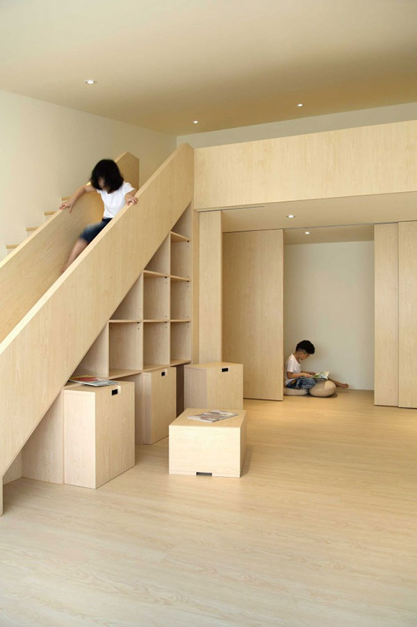 Superb Creative use of space for children to gather and play by Taiwan based design agency Yestudio The space integrates a slide as well as a bookshelf and