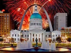 giant rotunda building with Saint Louis Archway behind, colorful fireworks with red, green and blue exploding in background