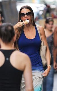 SOFIA VERGARA enjoying her vanilla ice cream like a pro