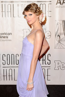 Celebrity Taylor Swift bobby pinned curly updo hairstyle