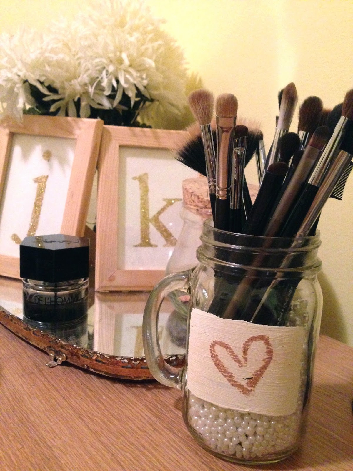 mason jar makeup brush holder. i know a few other beauty bloggers and diy-ers have made their own versions of these types makeup brush holders, but decided to create my unique mason jar holder c