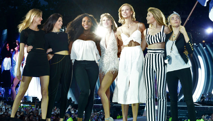 Taylor Swift performing on stage for her 1989 concert tour with friends Kendall Jenner, Serena Williams, Karlie Kloss , Gigi Hadid and Cara Delevigne