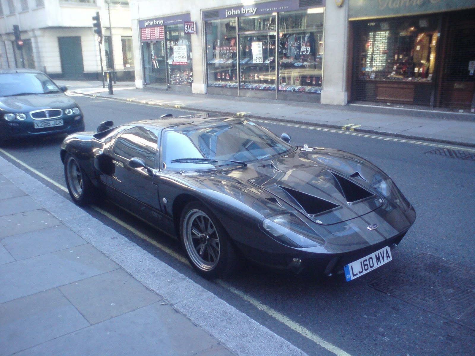 A Ford Gt On Jermyn Street On Autumn Sunday Morning Rain On The Roof At Galvin In Old Spitalfields Market The Famous Black Helicopter Flying Away From