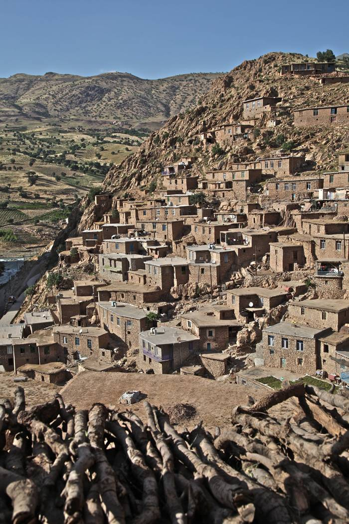 Palangan (meaning leopards in Persian) is a village located 47 kilometers north-west of Kamyaran in Iran's Kurdestan province. This village is spread over both sides of a valley. All of the houses are made of stone and like a staircase they are in a continuous pattern, i.e. the roof of one house is the yard of another house. This village is one of the most beautiful villages of the province not only because of its unique architecture, but also because of its beautiful nature. It is located beside a river which flows into the Sirwan River. This area was one of the important regions of Kurdistan from Saljooqi period on and Palangan Castle which is next to the village over a mountain bears witness to this claim. (source: Islamic Republic of Iran's Minister of Interior)