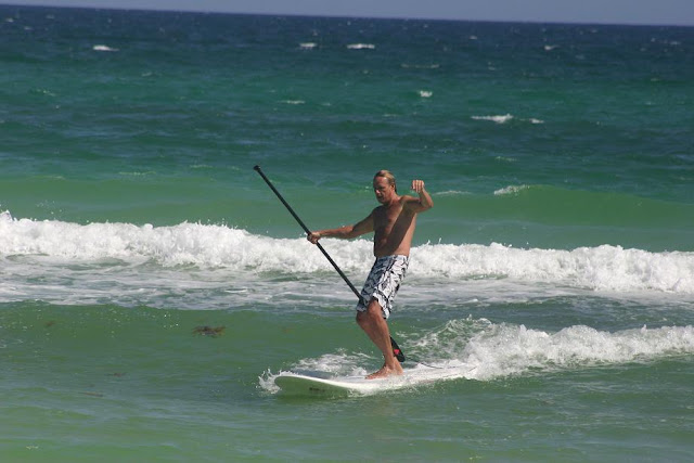 Cinco De Mayo 2012 Jimmy Chatwell standup paddle surfing on Pensacola Beach, FL at 18th Ave.