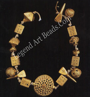 A collection of gold beads from Kumasi, Ghana, cast in the lost-wax technique, by gold-smiths using trade secrets passed from father to son. Made in the 1930s, the beads follow the traditional forms of the royal treasures of Asante chiefs.