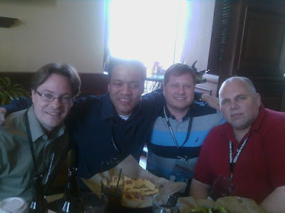 Joe, Jennison, Dennis, and John sitting at table for lunch.