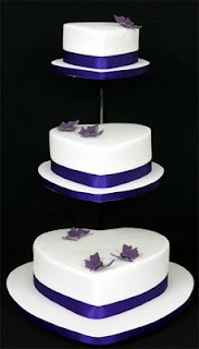 Three Tier White Heart Wedding Cakes Decorated with Blue Ribbons