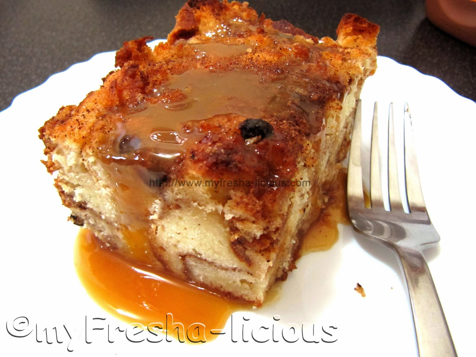 cinnamon bread pudding drizzled with Hershey's caramel sauce