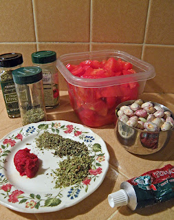 Chopped tomatoes, measured beans, and measured tomato paste and herbs