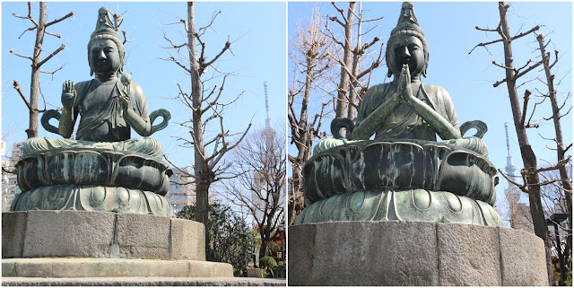 Two Buddha statues outside of the main temple's hall and near to Tokyo Skytree at Asakusa Sensoji Temple in Tokyo, Japan