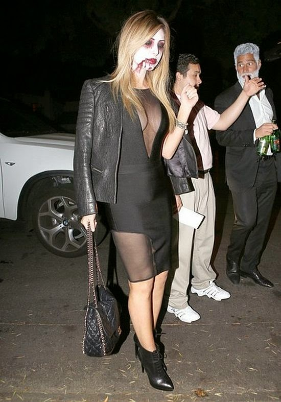The 31-year-old rounded off her look with a dark short dress for the Halloween party at the Casamigos Annual Party in Los Angeles, CA, USA on Friday, October 24, 2014.