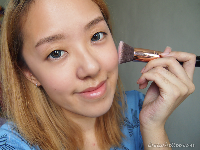 Apply makeup using Sigma Beauty F80 Flat Kabuki