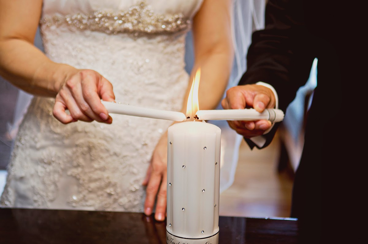 Unity candle lighting at Luis & Miki's wedding ceremony - Kent Buttars, Seattle Wedding Officiant