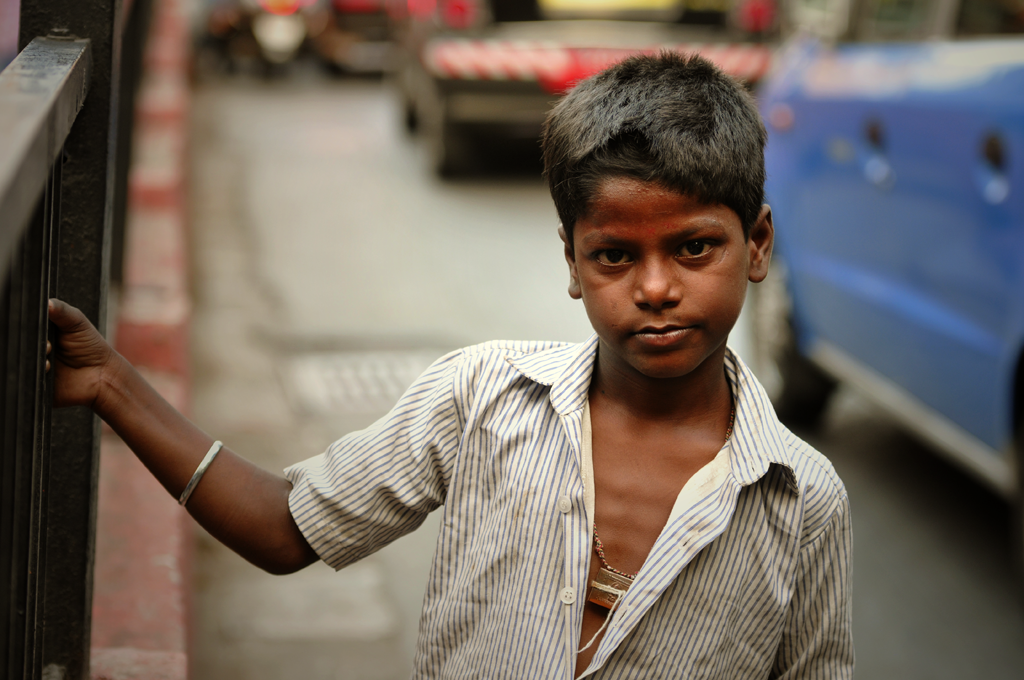 Boy in the streets of Mumbai in India.