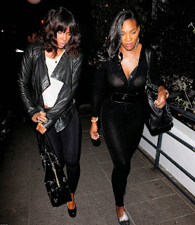 Serena Williams and Kelly Rowland in tight black leggings and transparent top