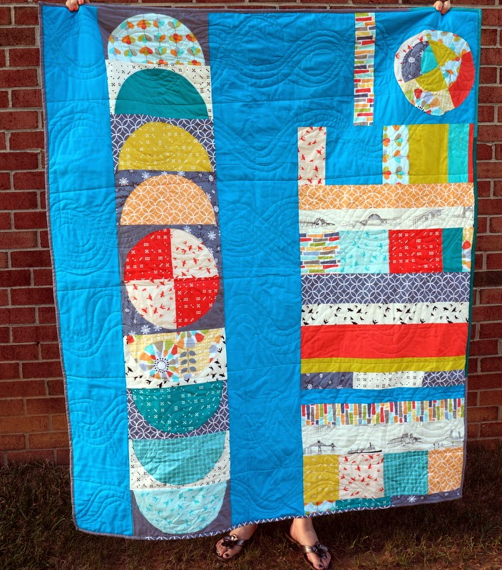 http://quiltyhabit.blogspot.com/2014/06/by-sea-finished-michael-miller.html