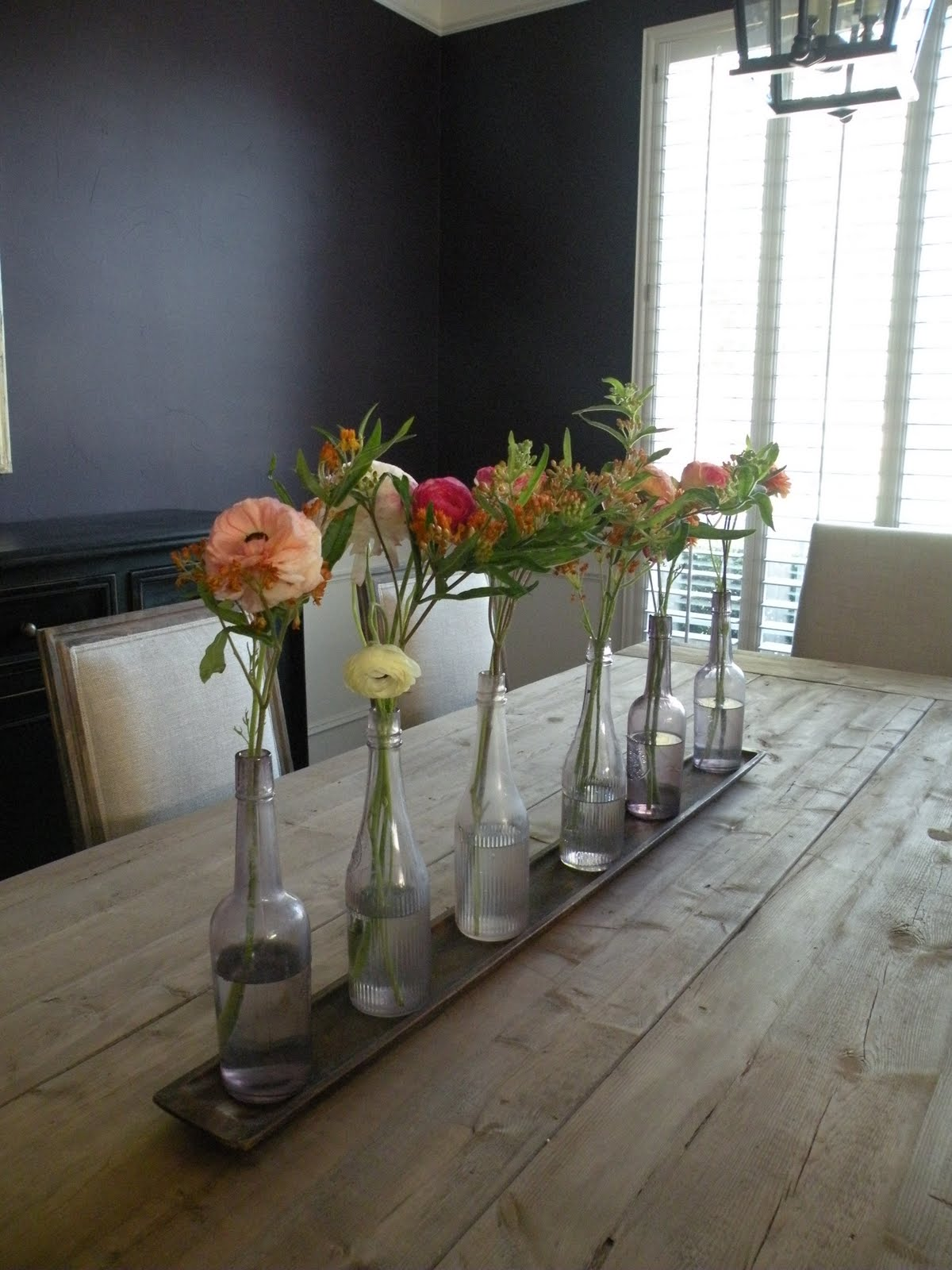 Flowers by b a rustic dining room table centerpiece at for Flowers for dining room table