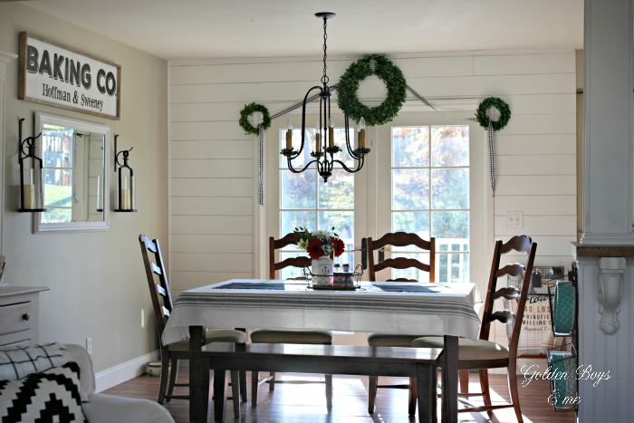 Dining area with wall planks - shiplap - and World Imports Brondy chandelier - www.goldenboysandme.com