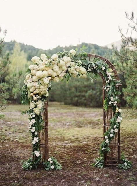 rustic wedding arch with white flowers