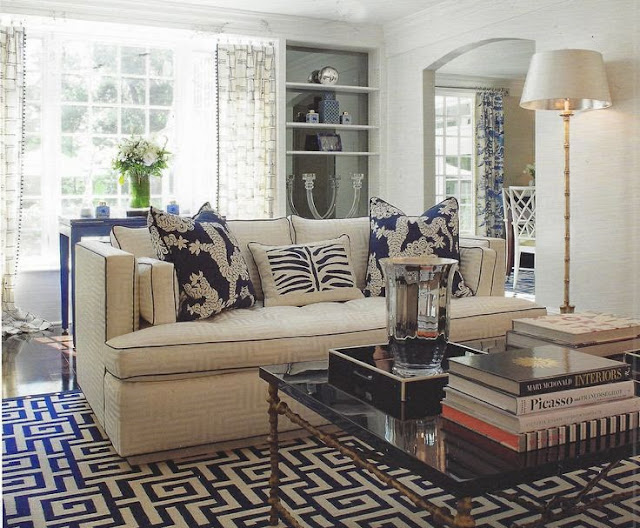 blue and white family room greek key rug coral accents coffee table styling