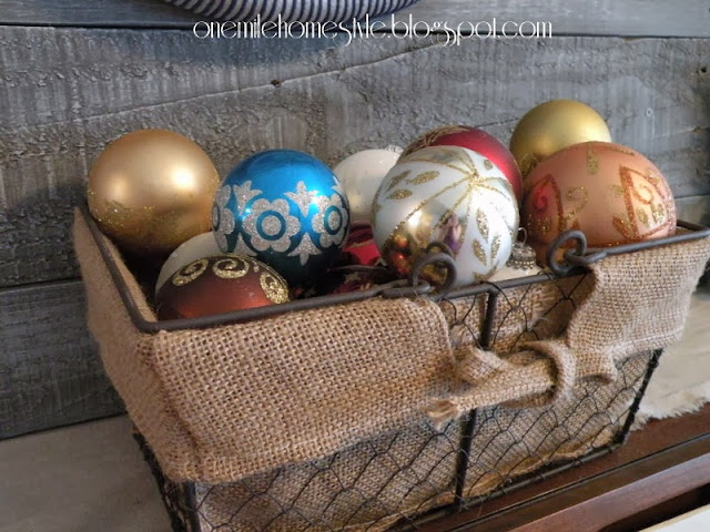Wire basket of Christmas ornaments