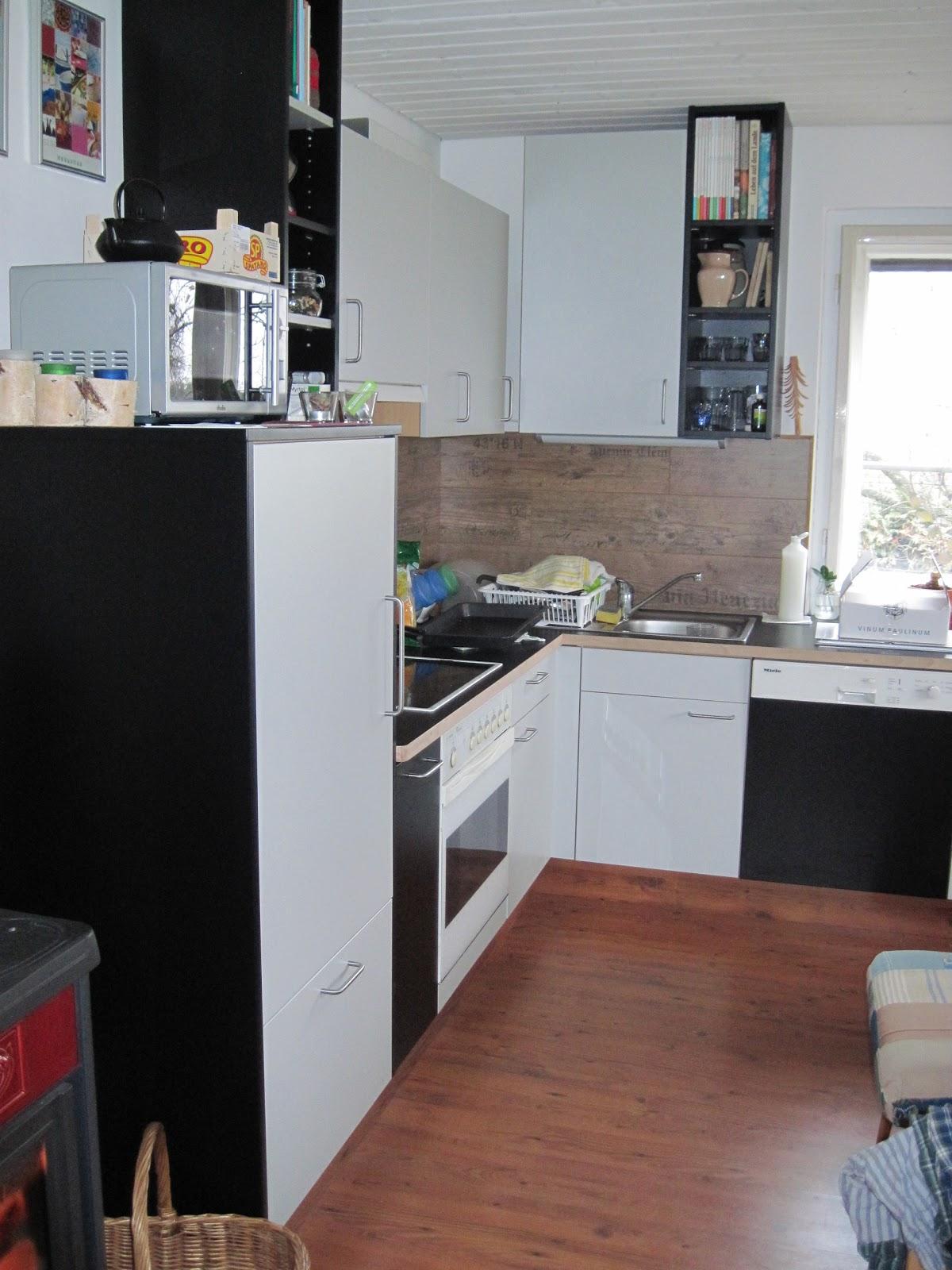 Willkommen: Küche mit Holzofen