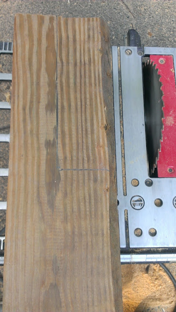 Using a table saw, set the blade height to cut the post.