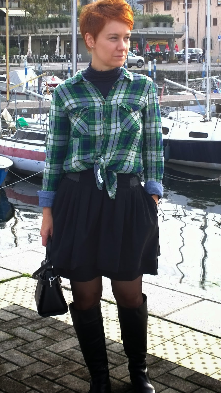 Marina of Iseo. Fall look. Plaid shirt over turtle neck, full mini skirt, tights, riding boots. And a little black bag | Funky Jungle - Mindful fashion & personal style blog.
