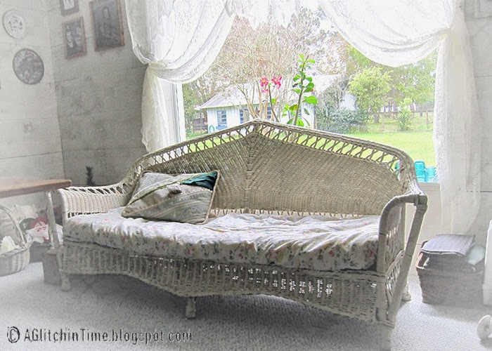 Wicker Couch in front of Studio Window