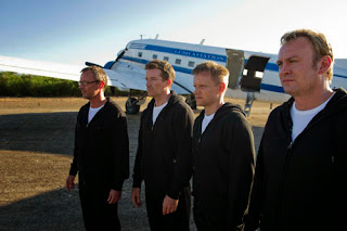 Sky1 Mad Dogs III - Episode 1 Exterior Airfield South Africa - The boys step out of the aircraft when its landed. Woody (MAX BEESLEY), Quinn (PHILIP GLENISTER), Baxter (JIOHN SIMM) and Rick (MARK WARREN)