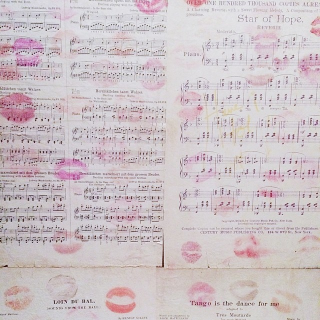 music sheets with lipstick kisses