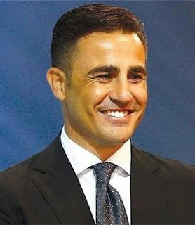 Fabio Cannavaro, coach of Guangzhou Evergrande, who is closing his eyes like if he already had Chinese eyes.