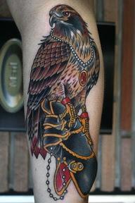 colored hawk tattoo with jewels