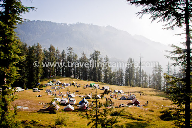 During recent trip in Himalayas, we also visited a small village called Ghda Kuffer with amazing natural beauty. We reached this place after crossing various hills, raw roads and dense forests, but all was worth... Let's have a quick Photo Journey of this place in Shimla region of Himachal Pradesh...This was our camping ground. It was actually a natural ground in the middle of dense forest with high cedars and pine trees. Although it was just beginning of October, but it was too cold out there. Weather made our experience more interesting :)Tents were installed all over Ghada Kuffer. This place was not close to the village but very approachable. There are 3-4 shops in the village for regular stuff. It was around 10 minutes walk to these shops and a beautiful water pond in the middle of Ghada Kuffer Market.As we start moving towards Ghada Kuffer village or market, the camp ground looked more beautiful. It was a climb from camping ground to Ghada Kuffer Market, although not very steep. For some of us it was easy and few of u were not very comfortable in taking short-cuts, so a dedicated road was also there which takes 10 minutes extra...Ghada Kuffer resident with typical Himachali Cap. Usually this cap can be seen in upper Himachal region, but at some places natural flowers are also added on top of it. And it's really surprising that flowers looks almost fresh all the time, unless cap is kept under pressure.A water pond near Ghada Kuffer Market... There are Various houses around this pond and folks in the village are mainly dependent on agriculture and Apple business. Although not everyone has Apple business.There are lot of such beautiful places in Hills of Himachal Pradesh and state of India, but least explored. Many time Himachal Tourism visited this place for analyzing the scope of tourism, but nothing happened till. This is what villagers told us.In past some of the folks also constructed their houses in a way that later, one portion can be converted into Guest-h