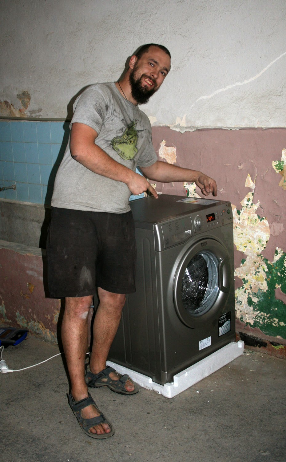 Proud man and his washing machine