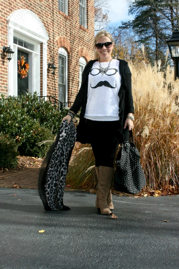 Fegalicious Lucy Boot, Black leggings with zippers from Zara, Punk Metal Necklace from Nordstrom, Forever 21 Fun Print T-Shirt, Long Black Ruffled Sweater, Animal Print Scarf from TJ Maxx, Studded Black Bag from TJ Maxx