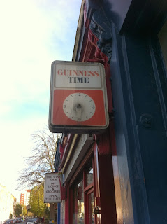 "Old advertising sign and clock for ""Guinness Time"", Greyhound Road, Fulham, London"