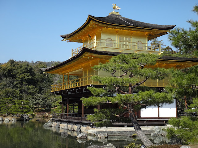 The side view of Kinkakuji (Golden Pavilion) is completedly covered in gold leaf in Kyoto, Japan