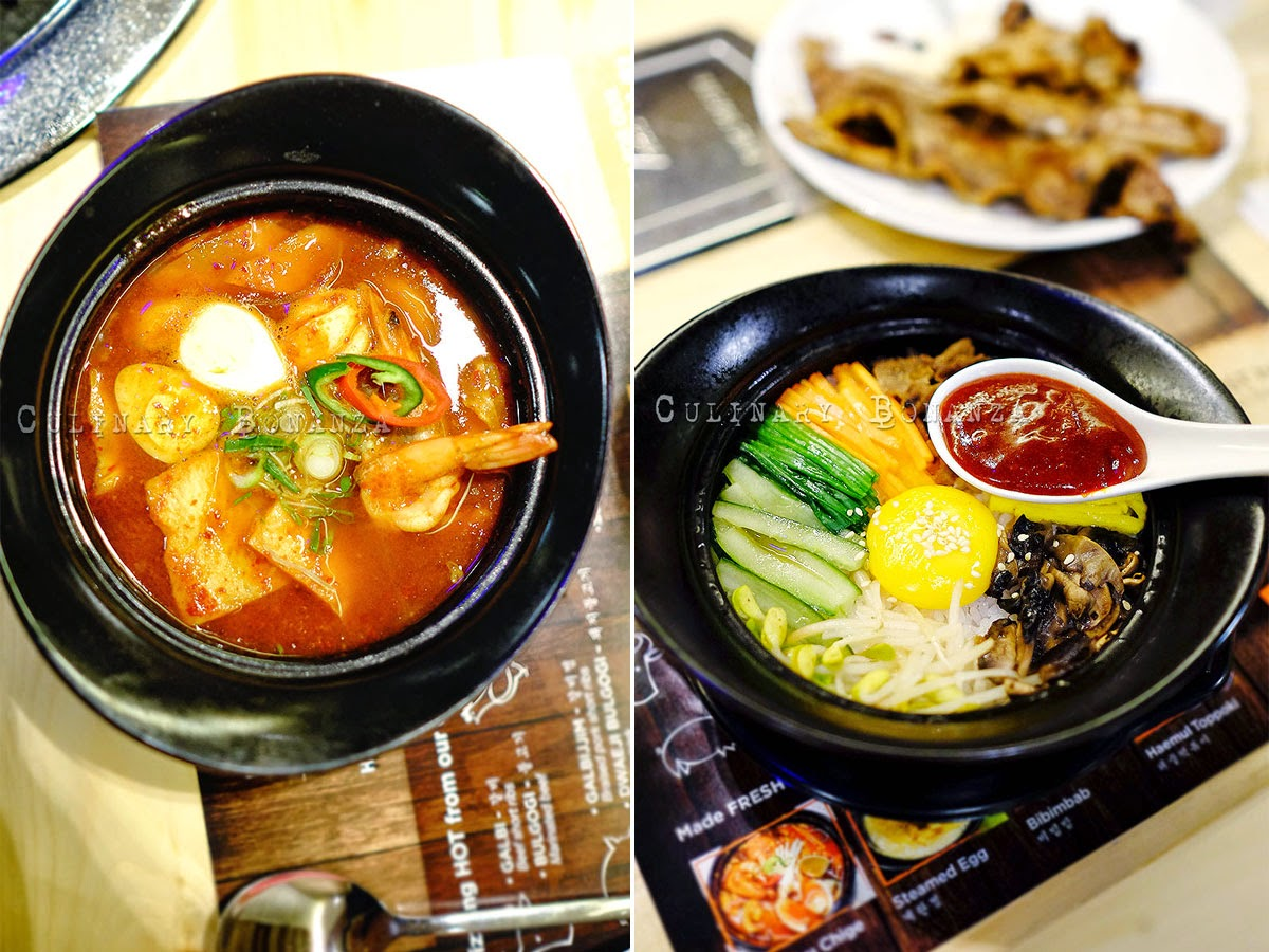 Bibimbap - Korean mixed rice bowl and Haemul Topokki - soft rice cake stew with fish cake and sweet red chili sauce