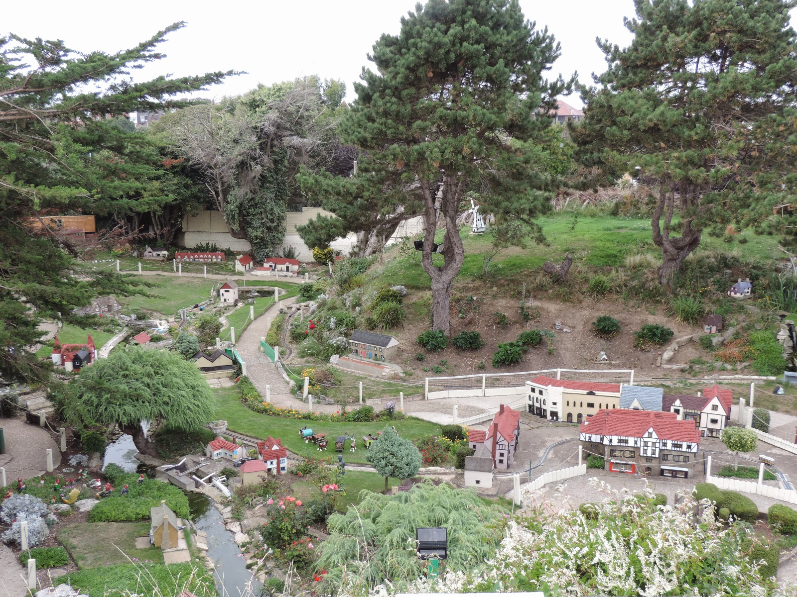 model village with waterways and model trains