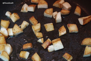 Mushrooms frying and browning in the pan