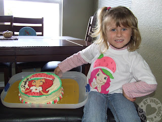 Girl in Strawberry Shortcake Applique T-Shirt with birthday cake