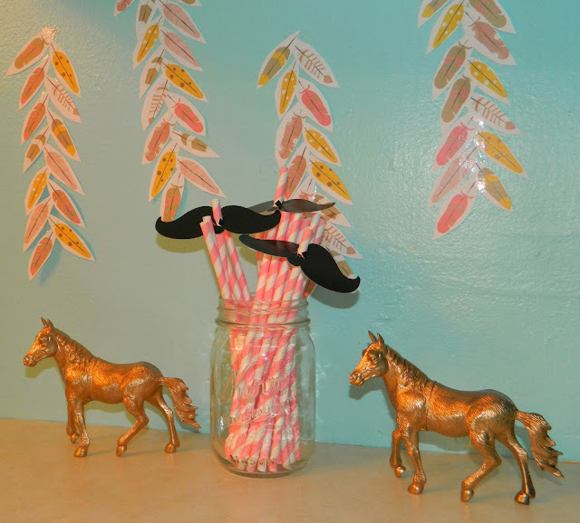 birthday party decor DIY cowboys Indians horses feathers mustache straws Just Peachy, Darling