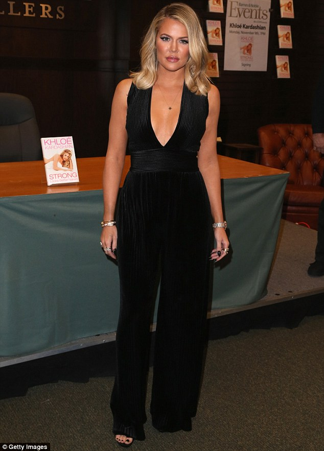 Khloe Kardashian in a plunging Balmain jumpsuit at book signing in LA