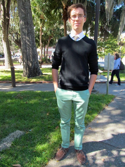 UF male student wears winter mint green pants and a black sweater
